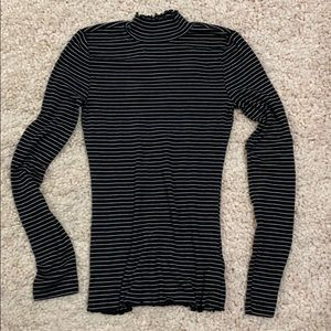 Black and white striped long sleeve mock neck top